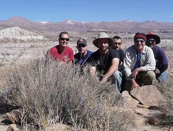 The group stopped for a group photo near Castle Rock and the Caspana Ignimbrite