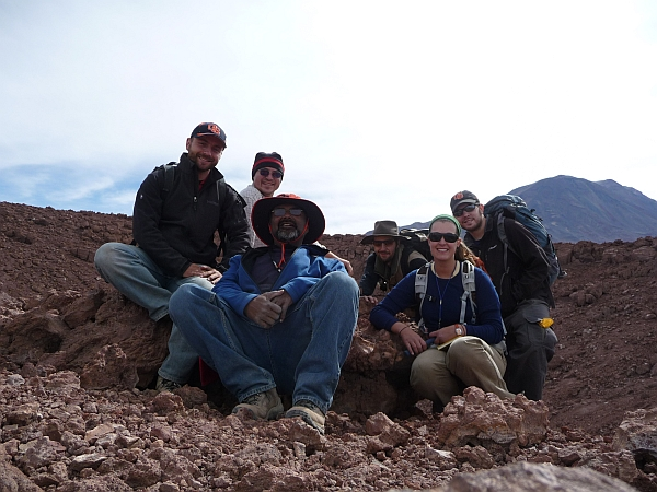The team poses for a group shot on top of La Poruna