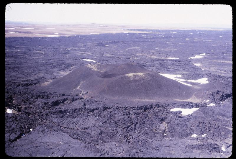 Aerial view of Lost Jim cinder cone and monogenetic volcanic field of Imuruk Lake, Seward Peninsula, Alaska. Photograph courtesy of Jim Clough, Alaska Division of Geological & Geophyiscal Surveys.
