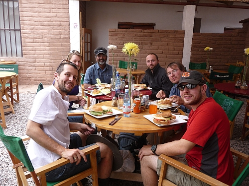 The team enjoys a meal in San Pedro de Atacama